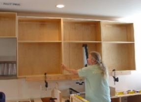 Lifting the cabinets...